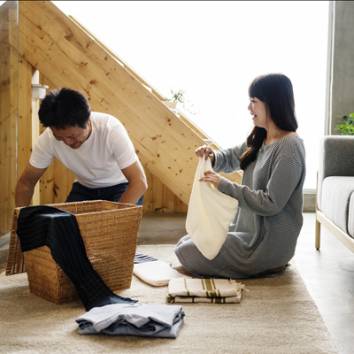 photo of couple putting linens away in their home